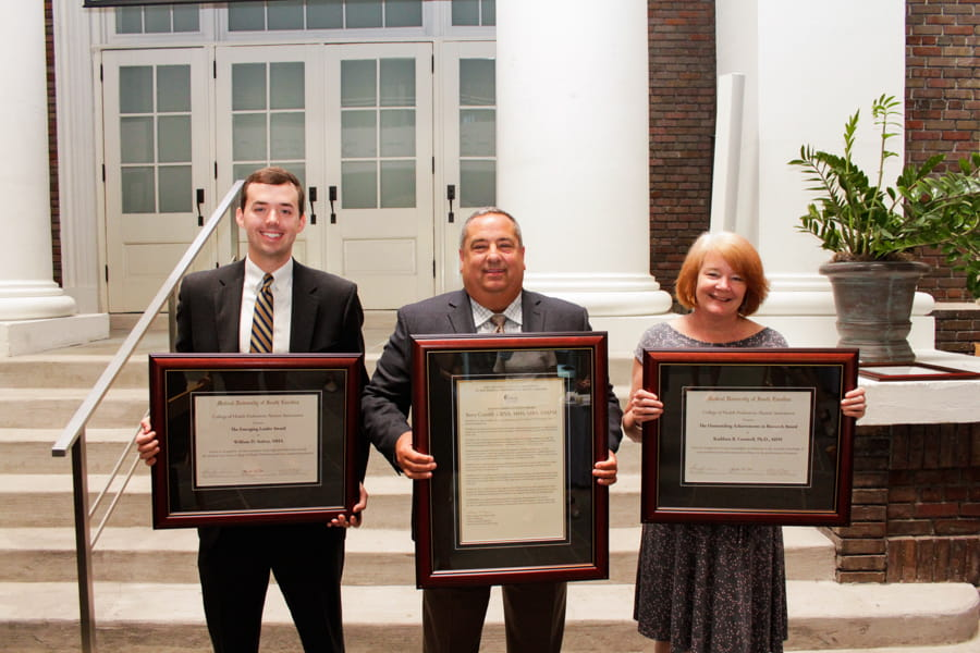 2019 CHP Alumni award recipients with their awards