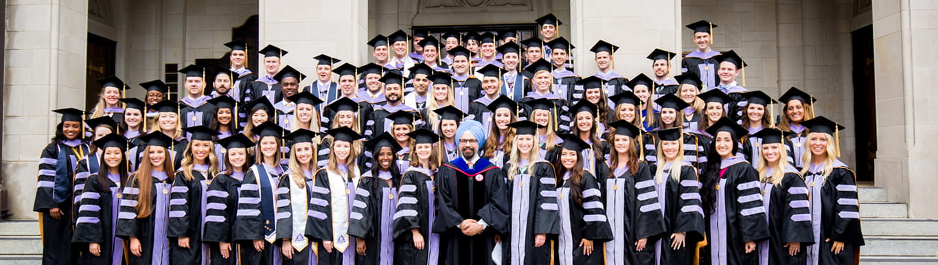 Dean Huja stands with 2018 Dental Medicine Graduates