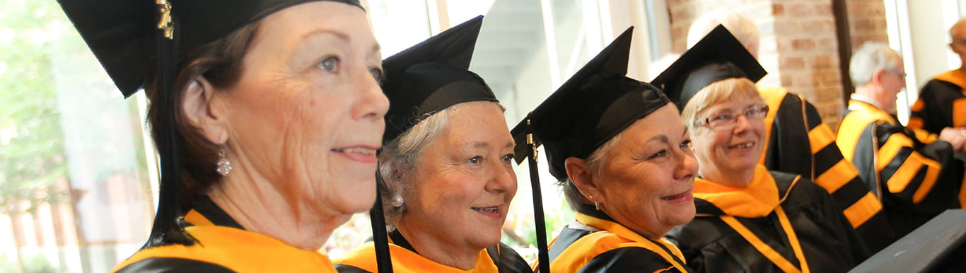 MUSC Golden Graduates in caps and gowns