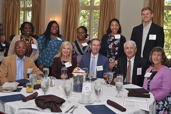 Drs. Gary and Benetta Bell, Barbara Inabinet, Dr. Buddy Inabinet, Dr. Sam Stone, Beverly Stone, and scholarship Recipients