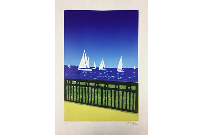 block print of white sailboats on blue water with black fence in foreground