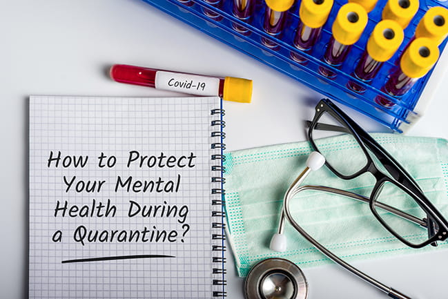 "notebook with ""How to Protect Your Mental Health During a Quarantine?"" with glasses, stethoscope and test tubes"