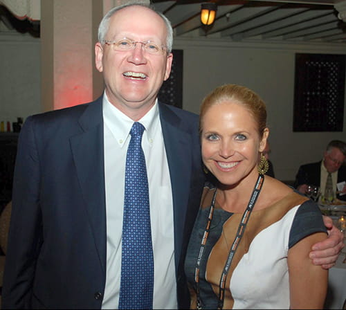 Raymond DuBois stands with Katie Couric