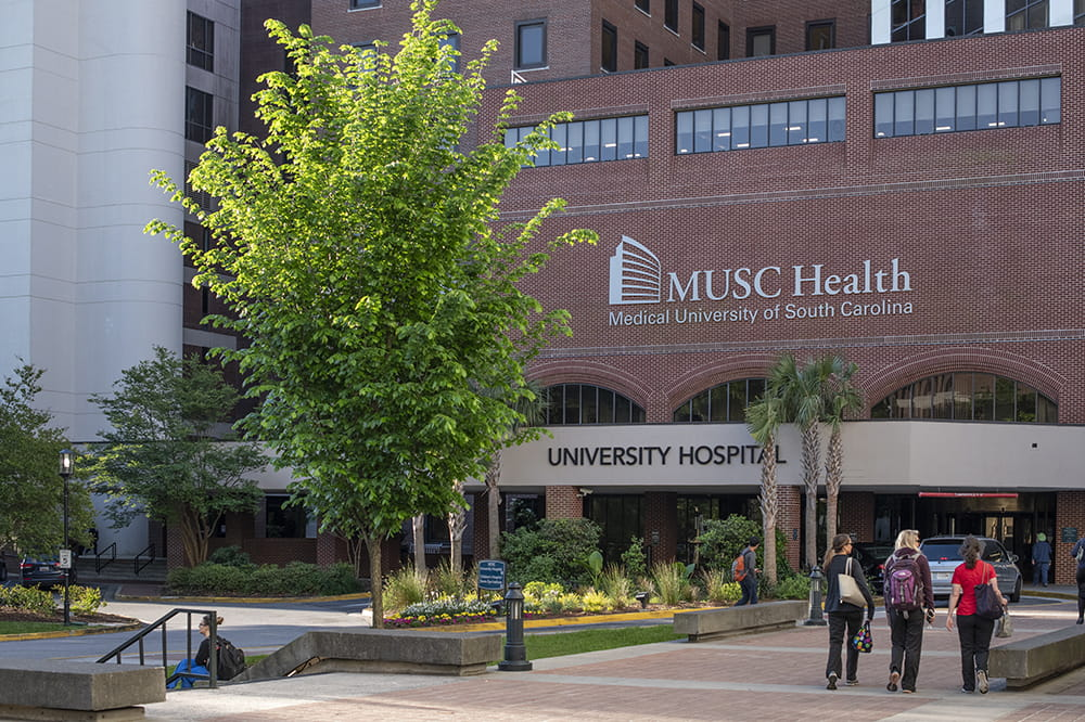 people walk toward the entrance of MUSC Health University Hospital