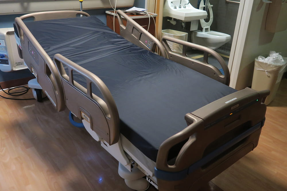 Hospital bed retrofitted with copper coating